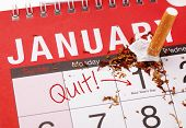 New year's resolution for quitting smoking with broken cigarette on the 1st January on a calendar