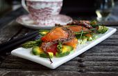Gentle salad with a salmon, a squid