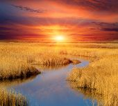 Sunset scene over small lake in steppe
