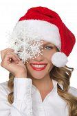 Beautiful Woman In Santa Hat With Snowflake
