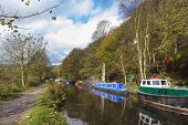 image of barge  - Barge on the canal in autumn England UK - JPG
