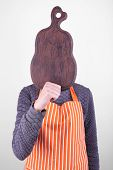 Cooker holding cutting board on light background