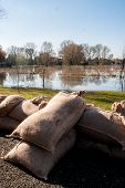 image of sandbag  - barricades of sandbags along the banks of the river - JPG