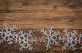 snowflakes lights on wood background