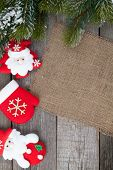 Christmas fir tree and decor on wooden table background with copy space