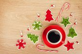 Coffee cup and christmas decor on wooden background with copy space
