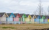 stock photo of beach-house  - Row of pastel coloured beach houses in England - JPG