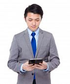 Business man look at tablet