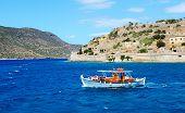 Spinalonga, Greece - May 14: The Motor Yacht With Tourists Is Near Spinalonga Island On May 14, 2014