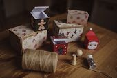 handmade christmas gift boxes on wooden table