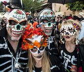 People In Dia De Los Muertos Masks And Makeup
