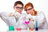 Two Students In Chemistry Lab Doing Reactions