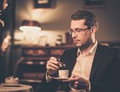 Middle-aged with cup of coffee in luxury vintage style interior