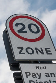 stock photo of mph  - 20 mph zone road sign seen in UK - JPG