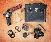 foto of enthusiastic  - overhead image of old dirty scratched up gear needed for old school film photography enthusiasts including two cameras - JPG