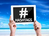 picture of hashtag  - Tablet pc with text Hashtags with beach background - JPG