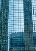 foto of skyscrapers  - skyscraper windows and reflected sky and the neighboring skyscraper abstraction - JPG
