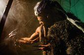 foto of werewolf  - Muscular man with skin and dreadlocks - JPG