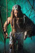 stock photo of werewolf  - Muscular man werewolf goes through the woods - JPG