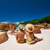 foto of couple sitting beach  - Couple sitting on a tropical beach at Seychelles - JPG