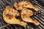 stock photo of barbecue grill  - Grilled Chicken Legs On The Hot Barbecue Charcoal Grill - JPG