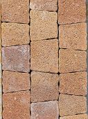 pic of trapezoid  - terracotta textured paving tiles imitating stone walkway with jagged edges - JPG