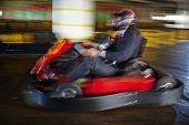 pic of karts  - Brave businessman racing in go - JPG