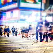 foto of mall  - Blurred image of people moving in crowded night city street with sopping malls - JPG