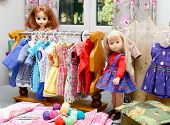 foto of doll  - two dolls with their clothes on a display unit - JPG