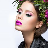 picture of pink eyes  - Beautiful girl with a lot of flowers in their hair and bright pink make - JPG
