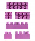 image of foreshortening  - Set of violet plastic toy construction block bricks isolated over the white background - JPG