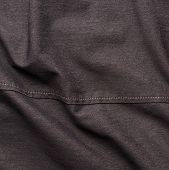 foto of black pants  - Creased black jeans cloth material fragment as a background texture composition - JPG