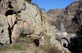 stock photo of armenia  - View of Geghard rock monastery with ancient khachkars Armenia Caucasus unesco world heritage site - JPG