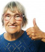 stock photo of 70-year-old  - Old happy woman showing ok sign on a white background - JPG