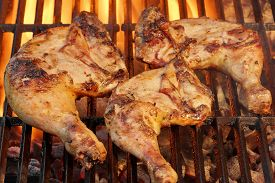picture of braai  - Marinated Chicken Legs Fried On The Hot Flaming BBQ Grill - JPG