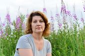 stock photo of willow  - Portrait of a woman near willow - JPG