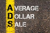foto of average looking  - Concept image of Business Acronym ADS as Average Dollar Sale written over road marking yellow paint line - JPG