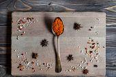 image of saffron  - Spice Saffron in old metal spoon over wooden background - JPG