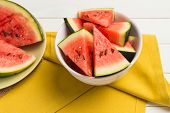 pic of watermelon slices  - Closeup of watermelon slices on wooden vintage background - JPG