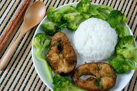 stock photo of fresh water fish  - Vietnamese food ca kho to or fish cook with sauce caramel fish a Asian eating raw material as fresh water fish onion garlic pepper this meal vey nutrition delicious - JPG