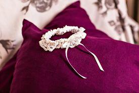 foto of garter-belt  - Beautiful wedding white bridal garter - JPG