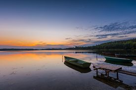 picture of dock a lake  - Beautiful lake sunset with fisherman boats - JPG