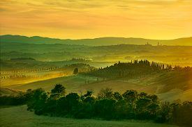 stock photo of farm landscape  - Tuscany rolling hills on sunset - JPG