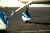 pic of cessna  - A small single engine cessna parked on the ramp - JPG
