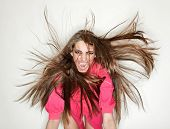 Screaming Furious Aggressive Brunette Lady With Flying Long Hairs, Ring Flash Studio Portrait On Whi