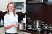 Beautiful Happy Smiling Woman In Kitchen Interior With Casserole