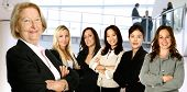 Mature Businesswoman Leading A Diverse Team Of Women