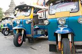 image of workhorses  - Thailand Motorised Three Wheel Transport at the temple - JPG