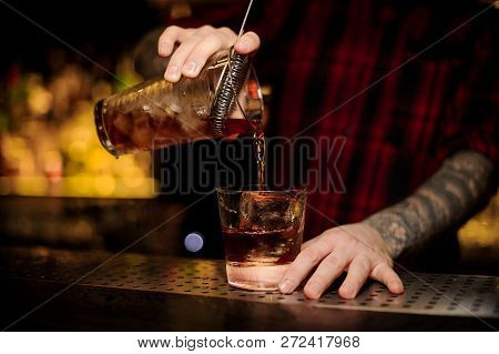 Bartender Pouring A Delicious Godfather