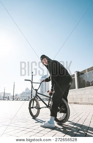 Portrait Of Cyclist Sitting On
